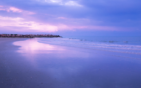 Dramatic coastline sunset with twilight time in blue and pink tone : Seascape