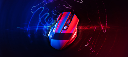 Top view of Professional wireless Game Mouse With hitech red and blue backgroud ; hight contrast