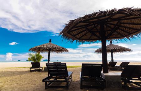 Wooden beach bed Under Parasol In Tropical Beach