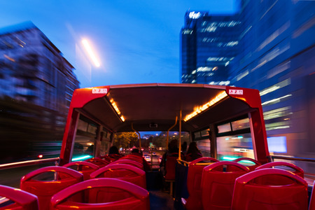 Long explosure of Cape Town City Sightseeing bus running through the city o evenning
