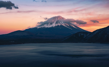 Beautiful Fuji mountain on evening  with cold weather at lake side