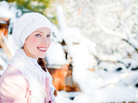 Portrait of beautiful young woman in snowy park  Stock Photo