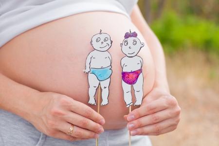 Pregnant stomach closeup, boy or girl