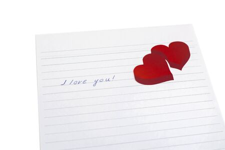 Red paper hearts on a white background with the words I love you