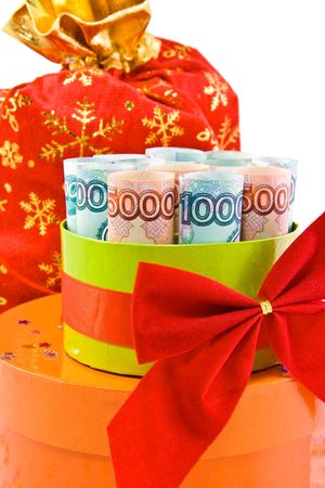 The convolve money in a gift box with red bowknot photo