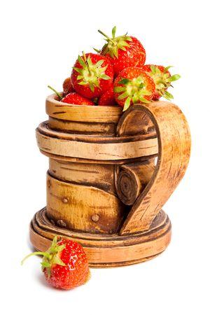 birchbark: Mug from a birch with a fresh strawberry