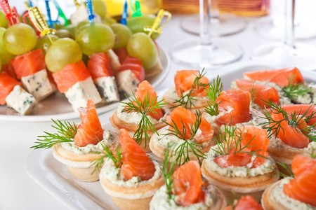 Snacks with salmon, cheese and grapes photo