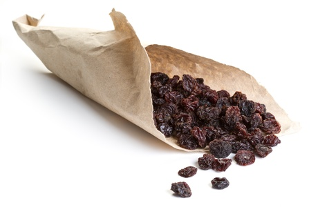 Raisins wrapped in paper on a white background Stock Photo - 11376793