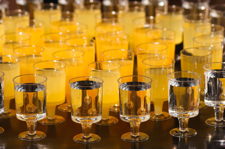 in the ranks: The ranks of glasses with drinks on buffet table Stock Photo