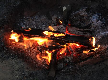 A bonfire at the night. The summer tourism camp