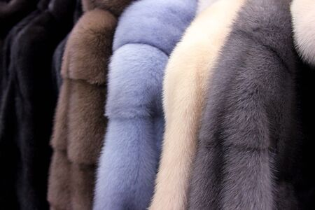 The fur coats. The fluffy background. In the wear shop Banco de Imagens