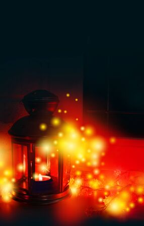 Magic Xmas still life in the red colors. Winter background for new year card. Candle, garland, window