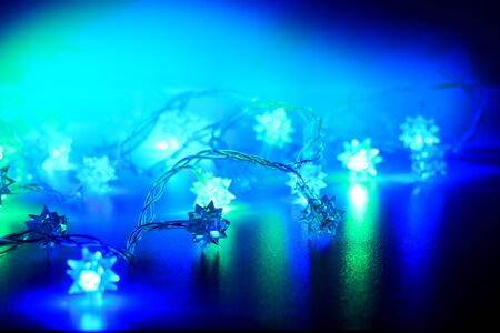 New year lights in blue colors. Christmas vibe. Garland as background