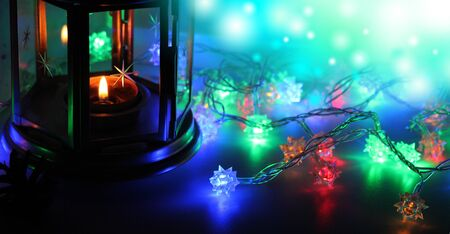 The magic new year lifestile with garland and candle. Xmas background for card