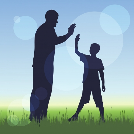 walking on hands: silhouette of man and a boy on nature background