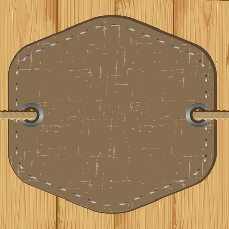 clothing label: blank leather tag on wooden background. vector illustration