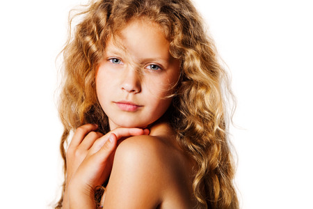 Portrait of pretty little girl with curly hair Stock Photo