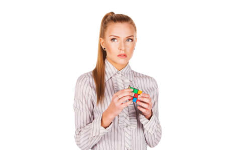 rubik: young woman concentrated solving the Rubik s Cube