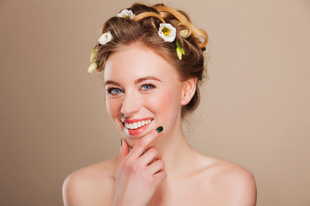 likeable: young happy woman with flowers  in her hair Stock Photo