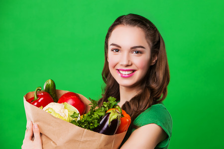food woman: young woman holding a bag full of healthy food. woman on a diet Banque d'images