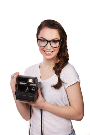 facial painting: closeup young woman in glasses and a Polaroid Stock Photo