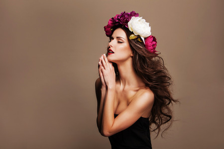 Fashion Beauty Model Girl with Flowers Hair. Perfect Creative Make up and Hair Style. Hairstyle.