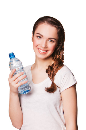 bootle: Beautiful smiling woman holding bootle of water. isolated on white