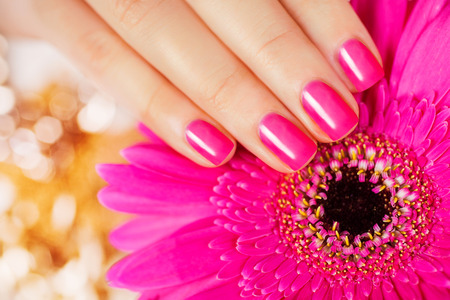 welling: Beautiful manicure. Pink manicure with delicate flower.