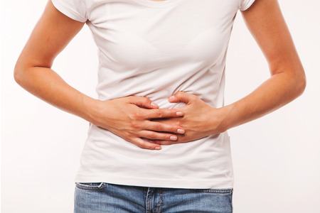 belly ache: Woman heaving belly ache, on white background Stock Photo