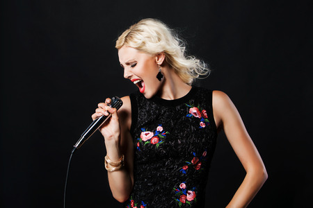 portrait of pop female singer with microphone