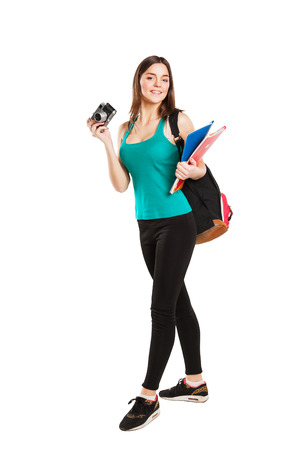 girl shirt: Beautiful young female student posing with notebooks and camera