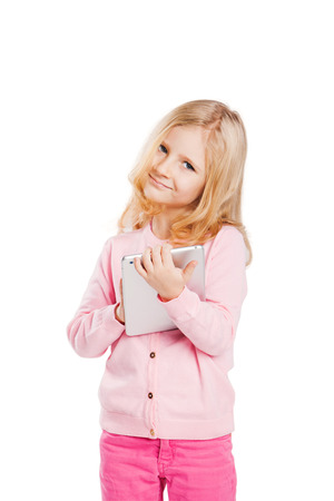 computer isolated: Happy little girl using tablet computer. Isolated on white