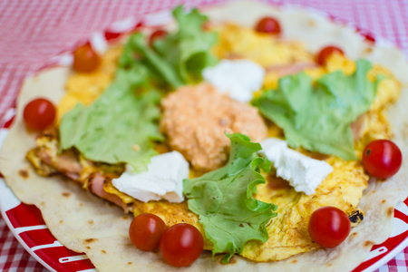 scrambled: Scrambled eggs, omelet with cucumber, feta cheese and cherry tomato