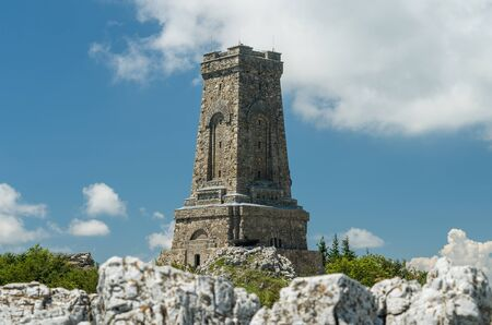 Monument to Freedom Shipka - Shipka, Gabrovo, Bulgaria. The Shipka Memorial is situated on the peak of Shipka in the Balkan Mountains near Gabrovo, Bulgaria. Summer view against the blue sky. Banco de Imagens
