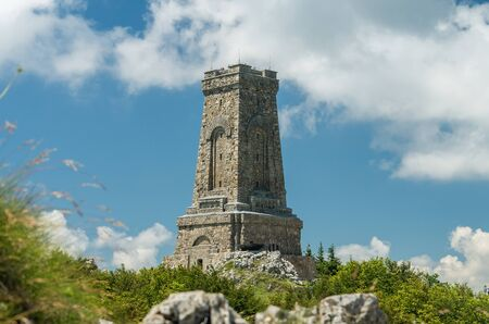 Monument to Freedom Shipka Bulgaria - Shipka, Gabrovo, Bulgaria. The Shipka Memorial is situated on the peak of Shipka in the Balkan Mountains near Gabrovo, Bulgaria. Summer view against the blue sky
