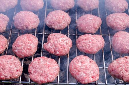 Grilling meatballs on the grill. Cooking  barbeque with charcoal in garden. Turkish cuisine.