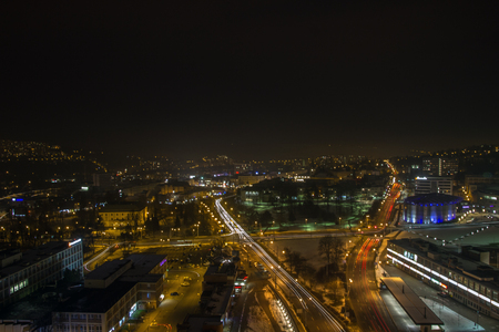 Evening picture of the city, hired transport and riding cars.