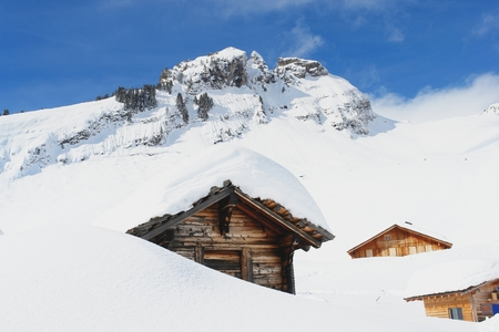 View of the mountain chalet in the Swiss Alps photo