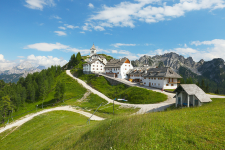 europe travel: View of the village of Monte Lussari in the Italian Alps, Italy Stock Photo