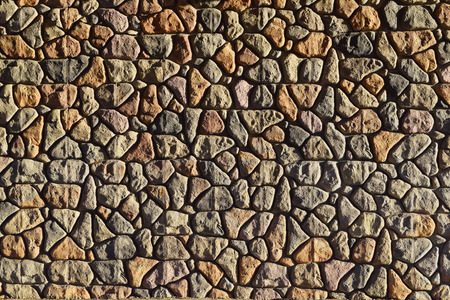 yellow stone: Rounded brown red yellow  stone wall background