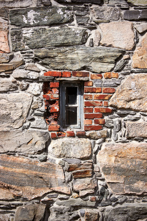 brick house: Rock wall and an old window