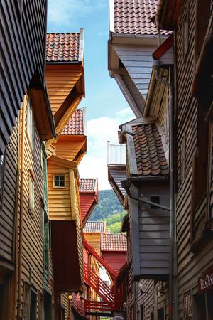 BERGEN, NORWAY - MAY 19, 2014: Colorful wooden houses, Bryggen, in the city of Bergen. Bryggen is also known as the Tyskebryggen.