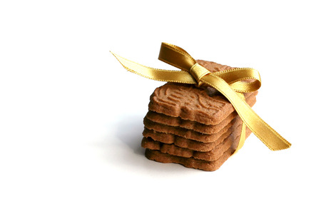 Tea cookies tied in a ribbon and isolated on white background