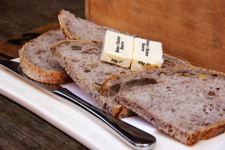Slices of bread with butter and a knife, breakfast concept, food photography Stock Photo