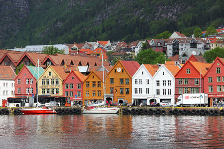 BERGEN, NORWAY - MAY 19, 2014: Colorful wooden houses  in Bergen. Bryggen is also known as Tyskebryggen. The view from the other side of the Fjord.