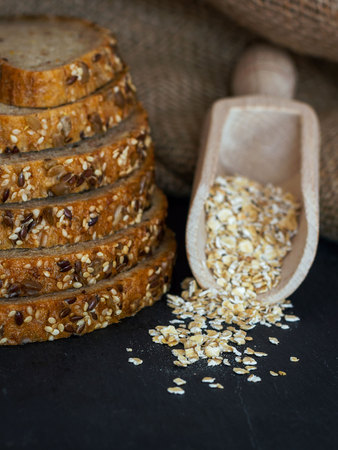 Bread selection with oats in a wodden spoon. Food styling
