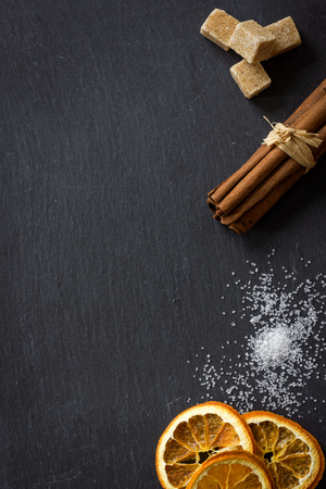 Collection of spices on dark stone plate, aromatic spices concept Stock Photo