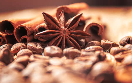 Anise stars and cinnamon on roasted coffee beans.selectiv focus .food Stockfoto