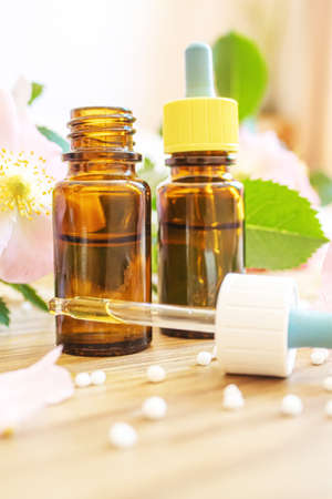 rosehip extract in bottles. Homeopathy. Selective focusnature
