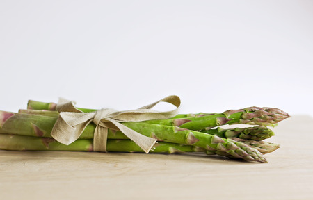 clamped: Green asparagus clamped with cloth rope